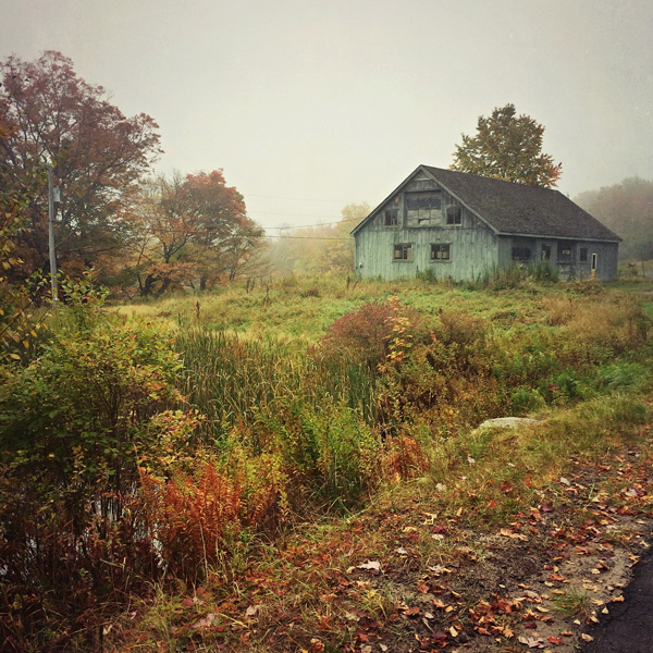 Autumn landscape with gray barn